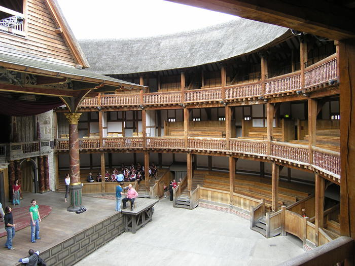 How has the design of theatre buildings changed over time for Open balcony in a theatre